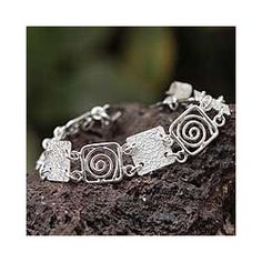 @Overstock.com - This sterling silver bracelet glows with dynamic artistry. The original design is by Perus Patricia Jara and features energizing spirals alternating with textured plaques that have been hammered by hand.http://www.overstock.com/Worldstock-Fair-Trade/Sterling-Silver-Energy-Link-Bracelet-Peru/6782803/product.html?CID=214117 $116.99