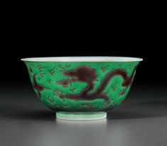 An aubergine and green-glazed 'Dragon' bowl Jiaqing six-character seal mark in underglaze blue and of the period (1796-1820)