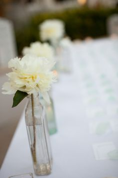 When I first laid eyes on this Vero Beach wedding, there was no going back. It was a head-over-heels, love at first sight kind of moment and totally convinced me that having your wedding day designed . Floral Wedding, Wedding Colors, Wedding Day, Book Centerpieces, Table Decorations, Event Planning Design, Vero Beach, Bud Vases, Pretty Flowers