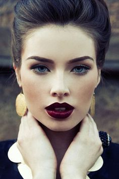 DANG this girl is breaking it down. I love her Merlot toned lipstick and defined brows....