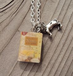 Chronicles of Narnia Necklace with Book and Aslan the Lion Charm. All of us narnians (hosanna production) need to get these!