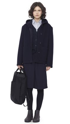 WOMEN AUTUMN WINTER 15 - Navy melton wool Hooded Jacket MHL, navy merino wool Scout Cardigan MHL, light grey cotton Single Pocket Shirt MHL, indigo cotton Overall Skirt MHL , navy Shetland wool Knee High Sock MHL, dark brown pvc Ankle Wellie MHL , black acrylic canvas 2 Way Rucksack MHL
