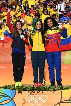 L-R] Silver medalist Alise Post of USA, gold medalist Mariana Pajon of Colombia and bronze medalist Stefany Hernandez of Venezuela on the podium after the Women's BMX Final on day 14 of the Rio 2016 Olympic Games at the Olympic BMX Centre on August 19, 2016 in Rio de Janeiro, Brazil.