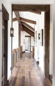 Reclaimed oak wood floors. The wood floors are antique reclaimed oak, with a water based finish.The product in this house has an original face on it - not sanded, which keeps the antique reclaimed wood floors looking very rustic. The water based finish keeps the coloring more brown than orange. Reclaimed oak wood floors #Reclaimedoakwoodfloors #oakwoodfloors Home Bunch's Beautiful Homes of Instagram @birdie_farm