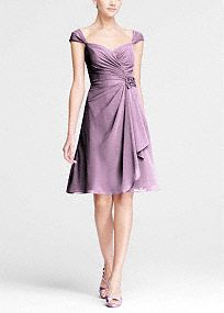 Airy and sweet, your bridesmaids will look picture perfect in this lovely dress!  Ruched bodice with sweetheart neckline features ultra-feminine cap sleeves.  3D flower detail at waist is eye catching and chic.  Soft chiffon cascading ruffles move vivaciously.  Fully lined. Back zip. Imported. Dry clean only.