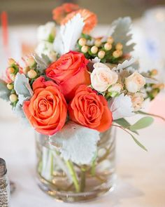 Red orange roses! I really like this centerpiece bc of the bold colors!   : @eileenliuphoto ||  :  @obfloral || #blushingjoyevents