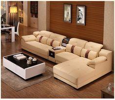 Светло-бежевый большой угловой диван в интерьере гостиной https://lafred.ru/catalog/catalog/detail/40722155764/