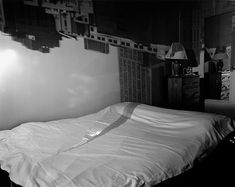 """""""I made my first picture using camera obscura techniques in my darkened living room in 1991. In setting up a room to make this kind of photograph, I cover all windows with black plastic in order to achieve total darkness. Then, I cut a small hole in the material I use to cover the windows. This allows an inverted image of the view outside to flood onto the walls of the room. I would focus my large-format camera on the incoming image on the wall and expose the film. In the beginning, exposu"""