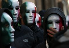 Members of Casapound far-right organization wear masks in the colors of the Italian flag before a demonstration.  Video chat about it at https://createamixer.com/