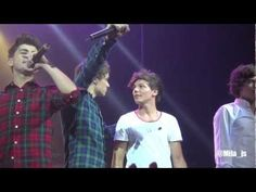 """One Direction - Save You Tonight - Front Row, Wellington NZ!Harry: """"you should open your eyes TAKE OFF YOUR CLOTHES, CLOTHEESS""""  *gets bombarded in the face with balls*  XD YOLO  <3"""