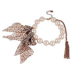 Betsey Johnson Jewelry PINKTINA LEOPARD RIBBON NECKLACE PINKALICIOUS !Fun! You can create a look of effortless sophistication with Betsey�s faux pearl necklace adored with a large leopard printed bow accent.  Crafted in a rose gold-tone mixed metal. Imitation pearl necklace Leopard printed bow accent  Rose gold tone chain with tassel Lobster claw Rose gold Metal/plastic/fiber 21mm Plastic 15 length + 3 extender; frontal drop 0.8 PINKTINA  Collection Limited Edition