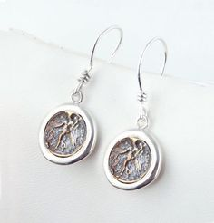 Coin Earrings, Rustic Coin, Nike, Victory, Strength - Sterling Silver Ancient Coin Earrings, Simple Design by ARTemisDesignsLLC on Etsy https://www.etsy.com/listing/477112186/coin-earrings-rustic-coin-nike-victory