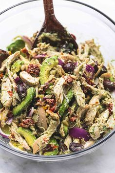 This easy and healthy Greek avocado chicken salad is chock-full of hearty and flavorful ingredients like sun dried tomatoes, olives, onions, avocado, feta cheese, and a creamy herb dressing to die for.