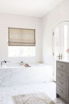 Look at the shade. marble tub, marble tiles, white subway tiles // clean, crisp, and modern bathroom renovation Luxury Interior Design, Home Interior, Bathroom Interior, Modern Bathroom, White Bathroom, Neutral Bathroom, Small Bathroom, Serene Bathroom, Colorful Bathroom