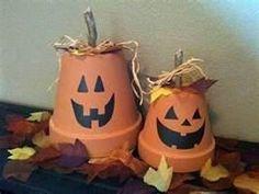 Cute Halloween decor with terra cotta pots
