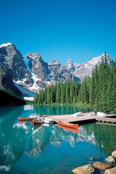 Canoeing surrounded by the Rocky Mountains, Canada.