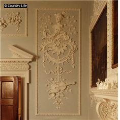Farnborough Hall in Warwickshire, England. The Hermes panel in the dining room. 18th century rococo plasterwork.