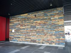 Very cool pallet wall with doors (you almost can't see them). Love the blues & yellows in this one.