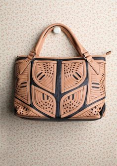 Arabian Nights Cut Out Bag By Melie Bianco ($94.99) via Ruche. I like the cutouts, wish it had a shoulder strap