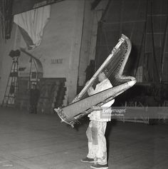 Worker moving a harp during the staging of La Scala in Milan. Milan