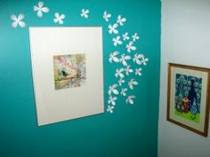 Umbra wall flowers....really like them, unfortunately a review says they  fall right off the wall!! Might have to try