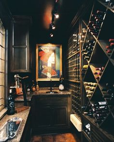 I like the black stained wood and black ceiling in this wine room.  The art makes it pop. Walk-in closet~ turned wine room