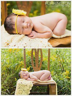 newborn girl in field of yellow flowers