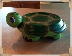 A cute little turtle made from clay pots and saucers.
