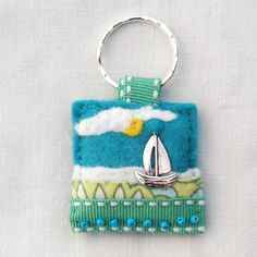 Hand sewn felt and fabric keyring with tibetan silver sailing boat charm - £7.00 www.elliestreasures.co.uk