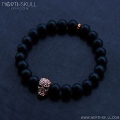 Explore the luxurious textures of our Matte Black Onyx / Rose Gold & Clear Crystal Skull Bracelet. The rich, smooth texture of the semi-precious matte onyx stones is perfectly complemented by our handcrafted rose gold loop & skull design. Set with precision cut clear Swarovski crystals, it's a luxurious mix of style and sophistication | Available now at Northskull.com [Worldwide Shipping]  #Luxury #Jewelry #MensFashion