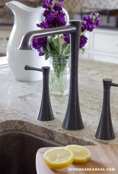 The sleek faucet and hardware combines modern lines with an aged look.