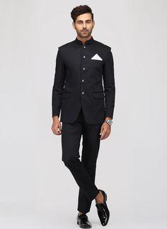 Black Italian silk Jodhpuri Suit features an Italian silk jacket with pocket handkerchief and Italian silk bottom. Indian Men Fashion, Mens Fashion Suits, Mens Suits, Fashion Pants, Wedding Dress Men, Wedding Suits, Rebel, Mens Ethnic Wear, Nehru Jackets