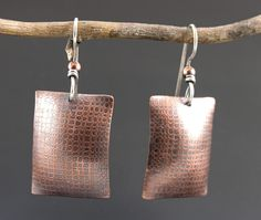 Billow....roller printed copper, domed and oxidized on sterling silver ear wires. Mikelene's Jewelry on etsy....sold