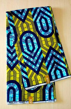 african print dresses This African Ankara fabric is sold per lot ( 6 yards ). It is a high quality fabric with vibrant colours. Latest design Yellow, blue and navy Cotton. African Fashion Ankara, African Print Dresses, African Prints, African Art, Ankara Fabric, African Fabric, Lace Design, Fabric Design, African Accessories