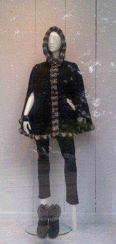 In the window: Hooded black cashmere cape with chinchilla trim; boots by Ugg