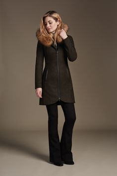 CHARLENE-F6 is a mid-length, slim fit coat in luxurious diagonal wool. The oversize hood is surrounded by a removable fur trim for multi-season wear. Features leather trim details and a removable bib and collar insert. This versatile timeless piece can be worn multiple ways, for multiple seasons. Discover at http://www.soiakyo.com/ca/en/charlene-f6-slim-fit-wool-coat-with-fur-hood-trim-in-moss-for-women