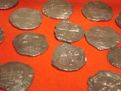 Gold Escudo coins from the Atocha wreck treasure hoard.