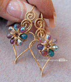 Looking for your next project? You're going to love Wire Wrap Earrings Charming Hearts 2 by designer Bobbi Maw.