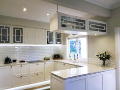 Beautiful white kitchen with a mix of contemporary and traditional feel. Custom designed and made cabinetry with brass detail. New Zealand made kitchen Custom Design, Kitchens, Kitchen Cabinets, Brass, Traditional, Contemporary, Detail, Table, Furniture
