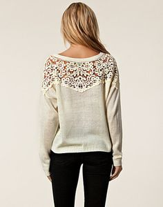 lace sweater, I bet this would be easy to make from a regular sweatshirt and lace.