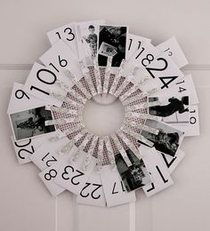 While I'm not necessarily a fan of the wreath, I like the idea of using photos as the advent calendar