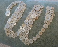 button monograms - simple yet pretty enough for te girls' rooms