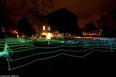 The web like maze is created using different coloured electroluminescent wire while music and conversation snippets are played to create a 'sound picture', Mr Kerr says