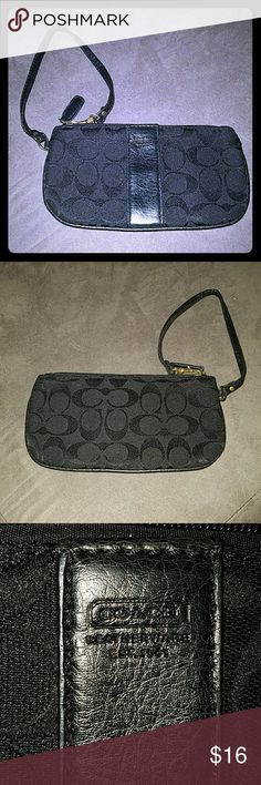*New Closet Item* NWOT Black Coach Wristlet NWOT Black Coach monogram wristlet. 8 in x 4 in. Coach Bags Clutches & Wristlets