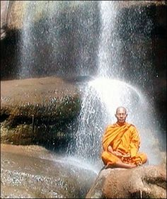 Thai Theravada forest monastery abbot meditating at waterfall