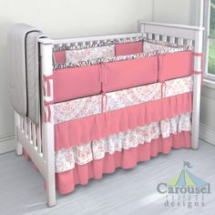 Crib bedding in Light Coral Floral Damask, Solid Almond Pink. Created using the Nursery Designer® by Carousel Designs where you mix and match from hundreds of fabrics to create your own unique baby bedding. #carouseldesigns