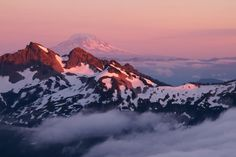 The last light of the day turns the sky pink over Mount Rainier National Park in Washington. Pictured here are the Tatoosh Range and Mount Adams at sunset as seen from the park's Skyline Trail.  Photo by Justin Marx (www.sharetheexperience.org).