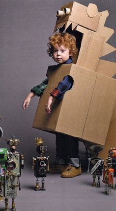 Make your kid a robot costume for Halloween and he'll love you forever. No directions; this photo was in the Anthropologie catalog. Costume Dinosaure, Cardboard Crafts, Cardboard Boxes, Cardboard Costume, Cardboard Robot, Cardboard Playhouse, Puppet Costume, Cardboard Animals, Cardboard Cartons