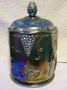 Carnival Glass Canister In Harvest Grape Antiques Value, Old Bottles, Perfume Bottles, Antique Cookie Jars, Blue Carnival Glass, Glass Canisters, Antique Glassware, Waterford Crystal, Indiana Glass