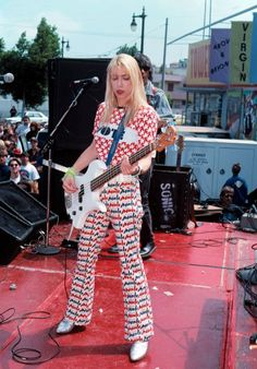 "Kim Gordon of Sonic Youth and author of ""Girl in a Band,"" is so much more than just that. Read more about her career and iconic style here. Kim Gordon, Guitar Girl, Bass, Best Guitar Players, Women Of Rock, Women In Music, Celebrity Wallpapers, Girl Bands, Margiela"